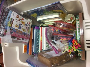 the bin of books and craft supplies